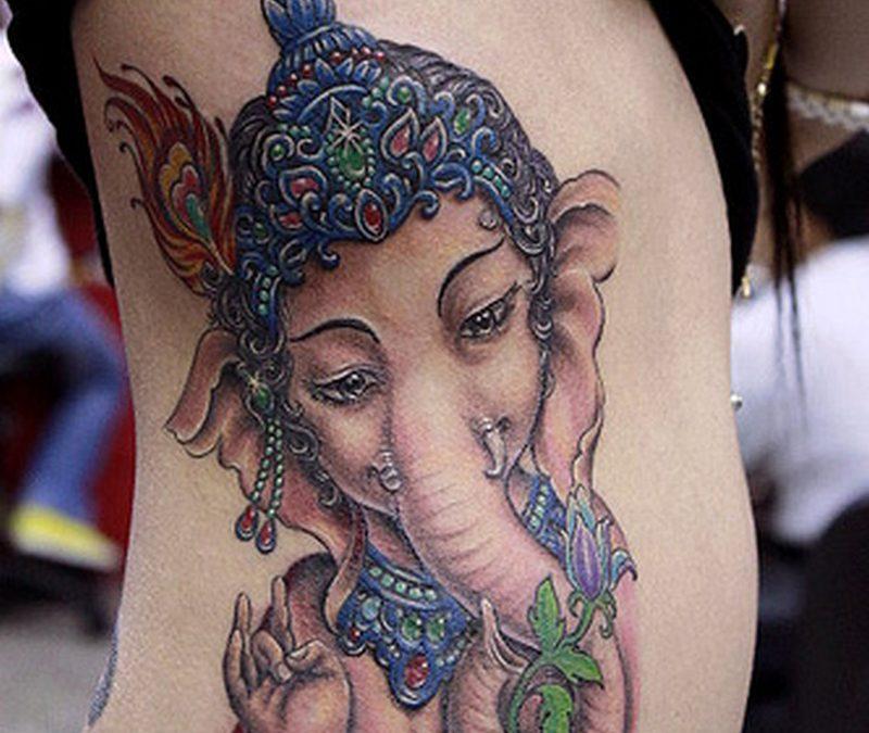 Ganesha hindu tattoo on ribs