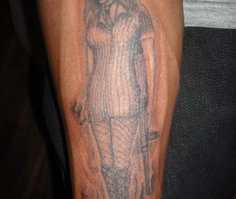 Gangster girl tattoo on arm