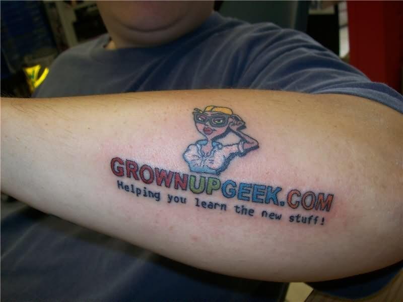 Geek grown up tattoo design on arm