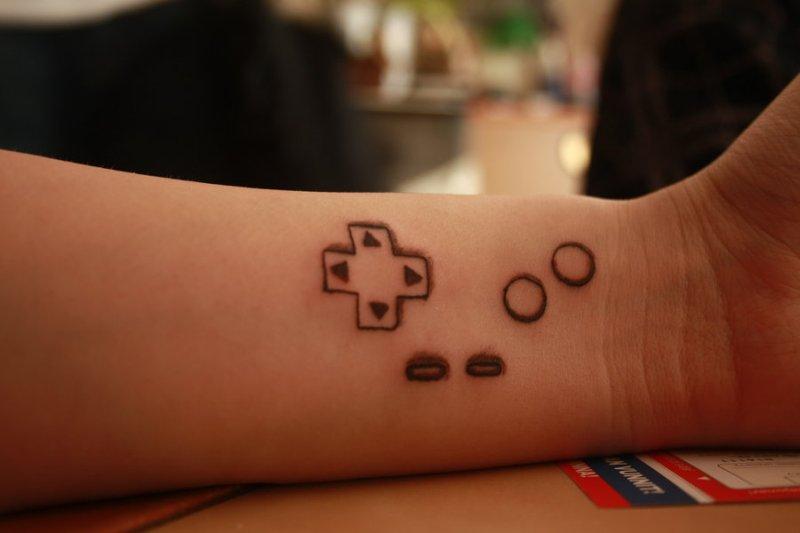 Geeky tattoo on wrist