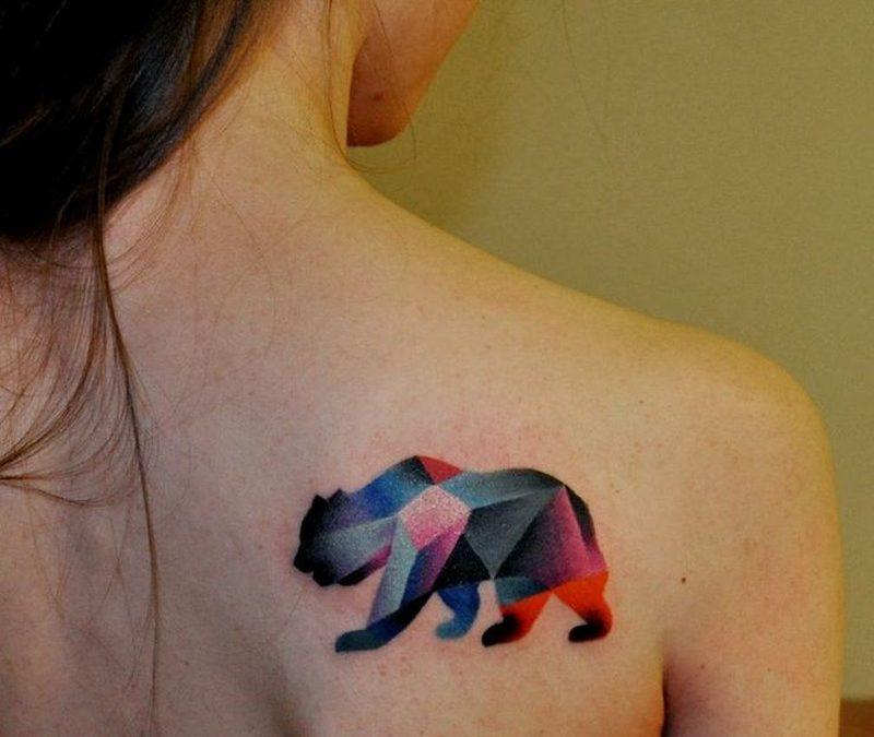 Geometric bear tattoo on shoulder blade