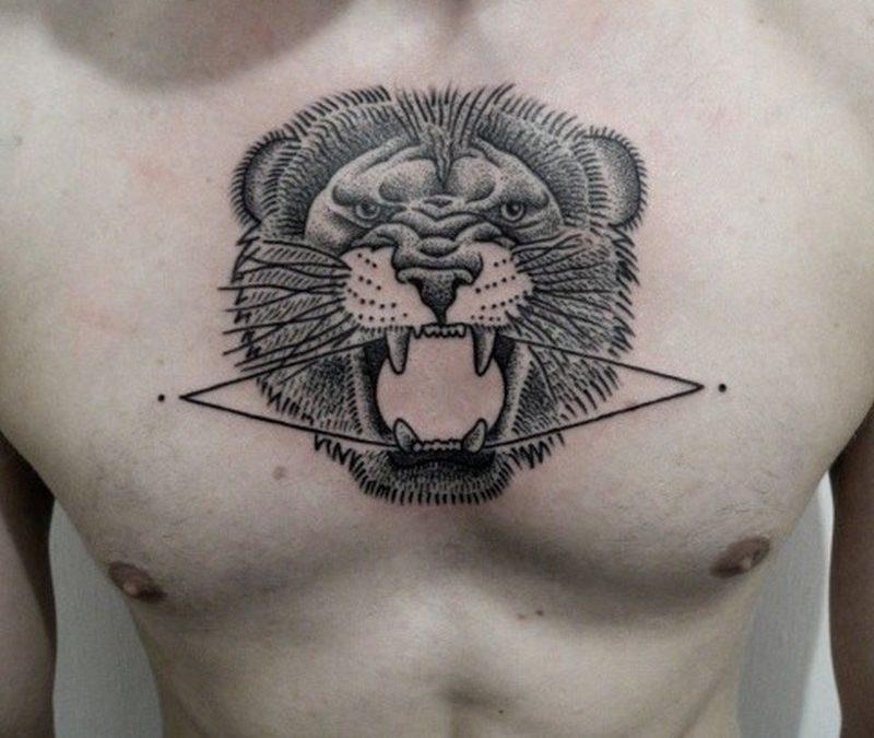 Geometric black ink tattoo on chest