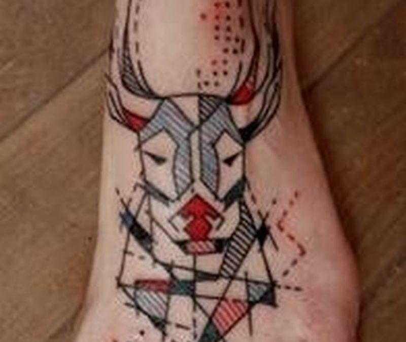 Geometric deer head tattoo on foot