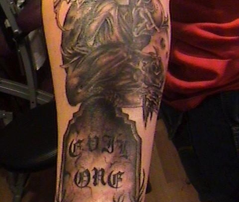 Grave stone tattoo design on forearm