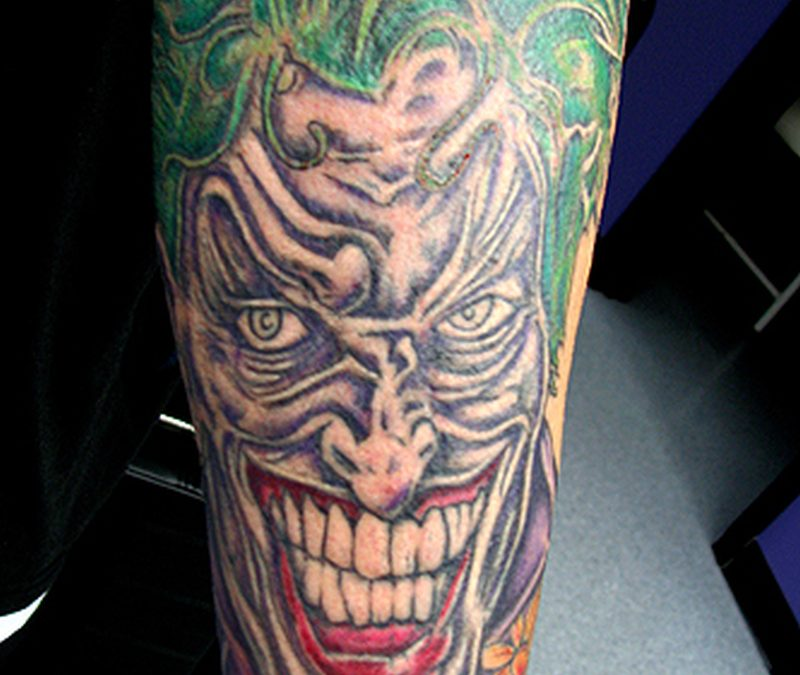 Green hair joker tattoo on leg