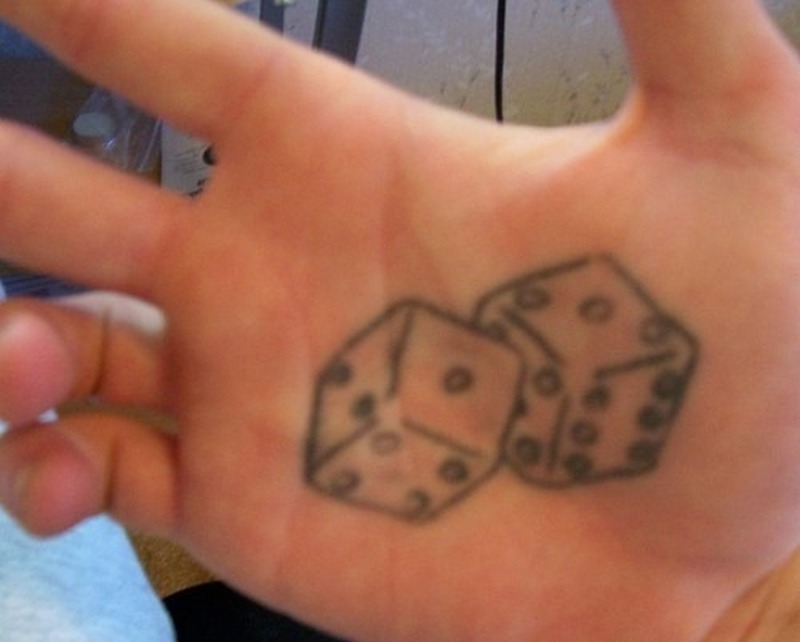 Grey ink dice tattoo on palm
