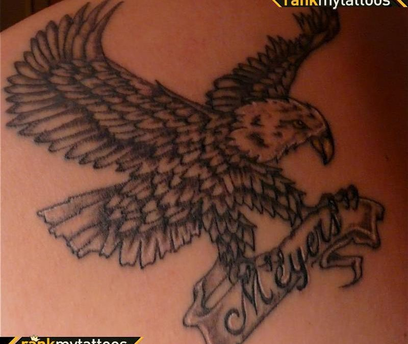 Grey ink eagle with banner tattoo design