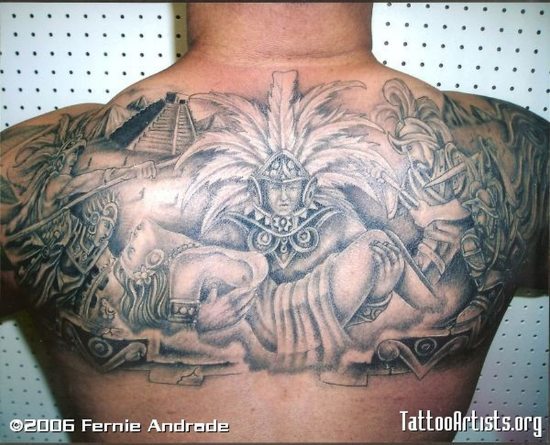 Grey ink upper back aztec tattoo designs