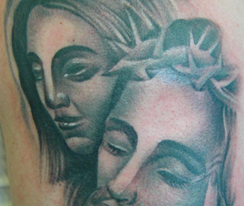 Grey ink virgin mary n jesus tattoo design