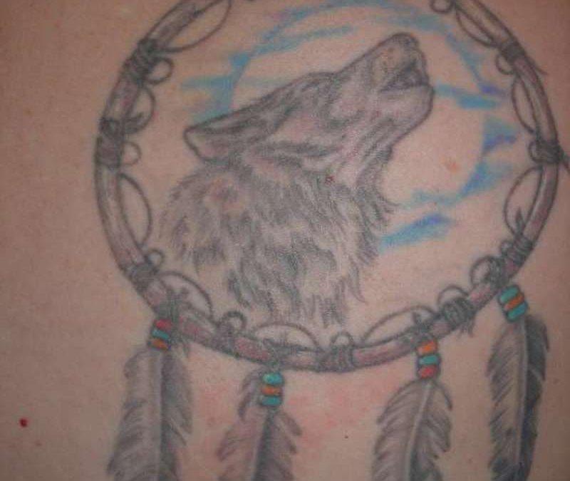 Grey ink wolf dream catcher tattoo design