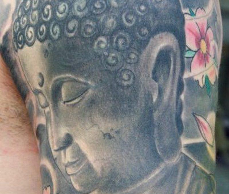 Half sleeve buddhist tattoo design