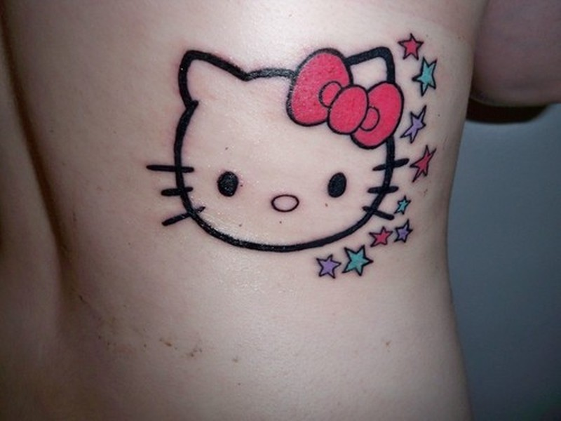 Hello kitty face tattoo on side back