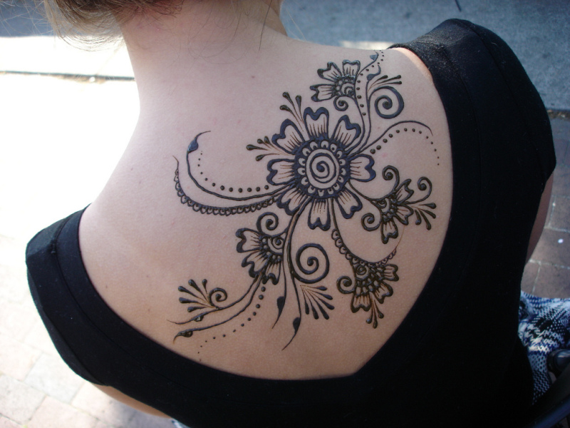 Henna flowers tattoo on upper back 2