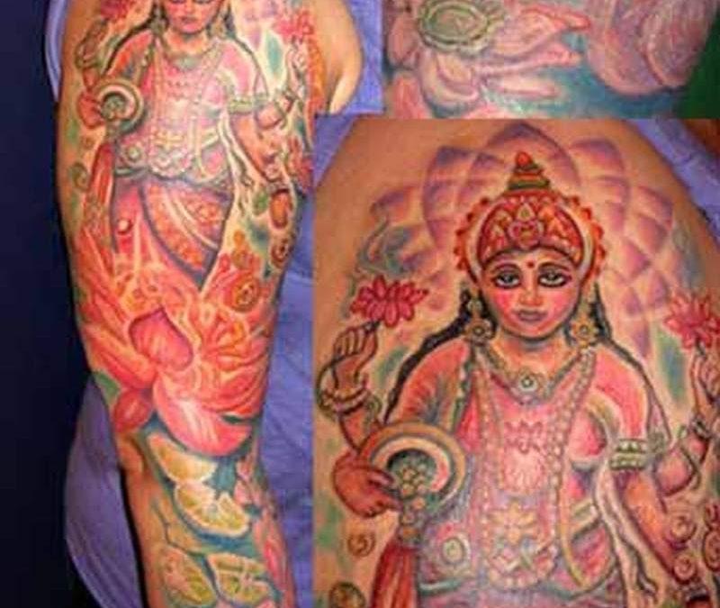 Hindu lotus swan tattoo on sleeve