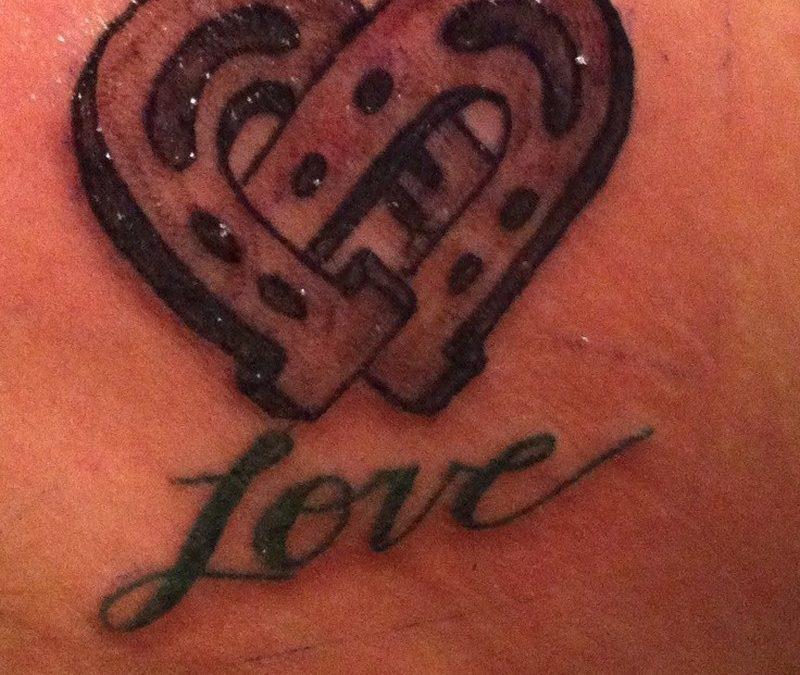 Horseshoe on love and happiness tattoo