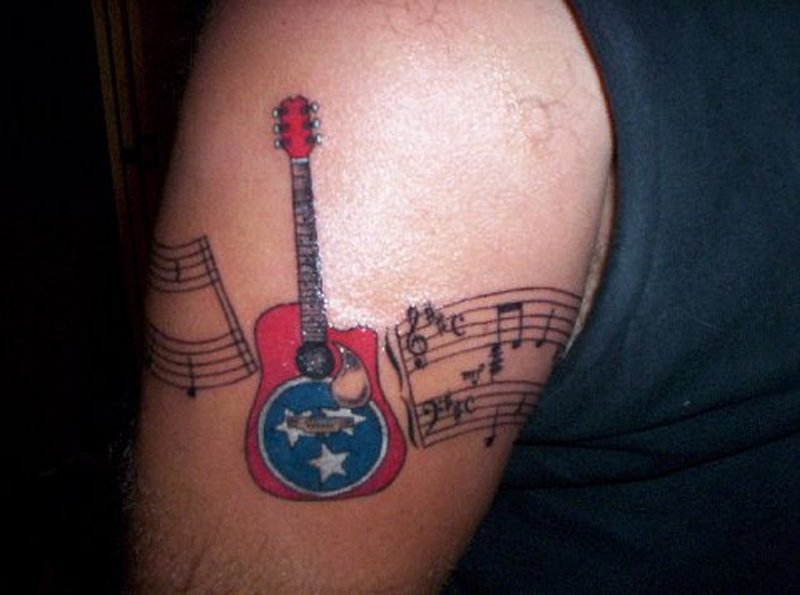 Musical guitar armband tattoo design
