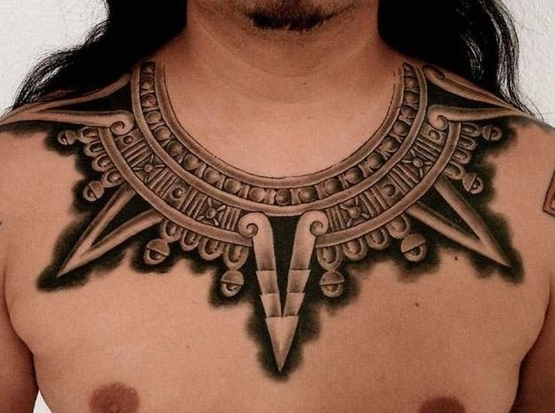 Necklace in style culture of aztecs tattoo on chest