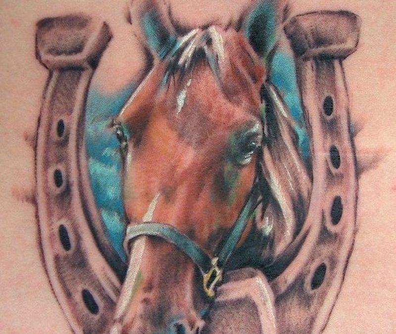 Nice lucky horseshoe and horse tattoo