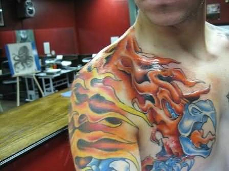 Phoenix flame tattoo on shoulder for guys