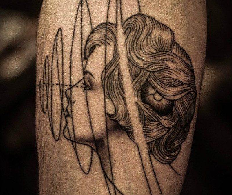 Portrait of a girl and geometric symbols forearm tattoo