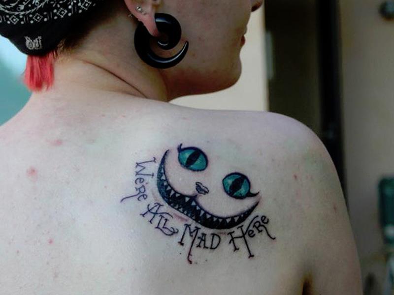 Quoted cheshire cat tattoo