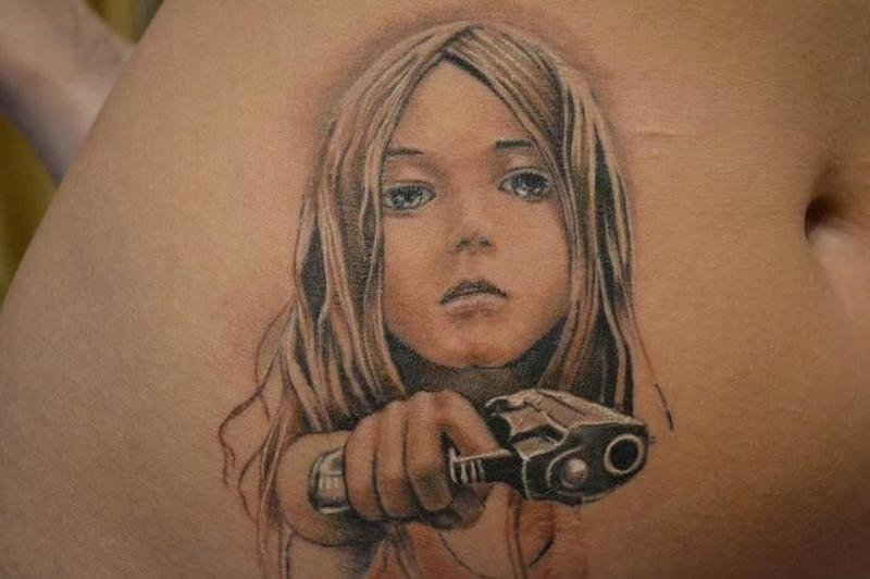 Realistic children gun tattoo on stomach