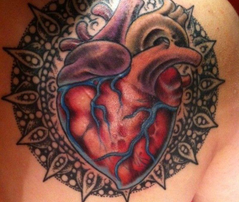 Realistic heart with mandala tattoo by Rob Hunt