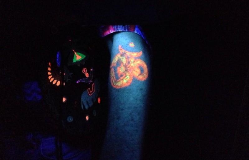 Religious om blacklight tattoo