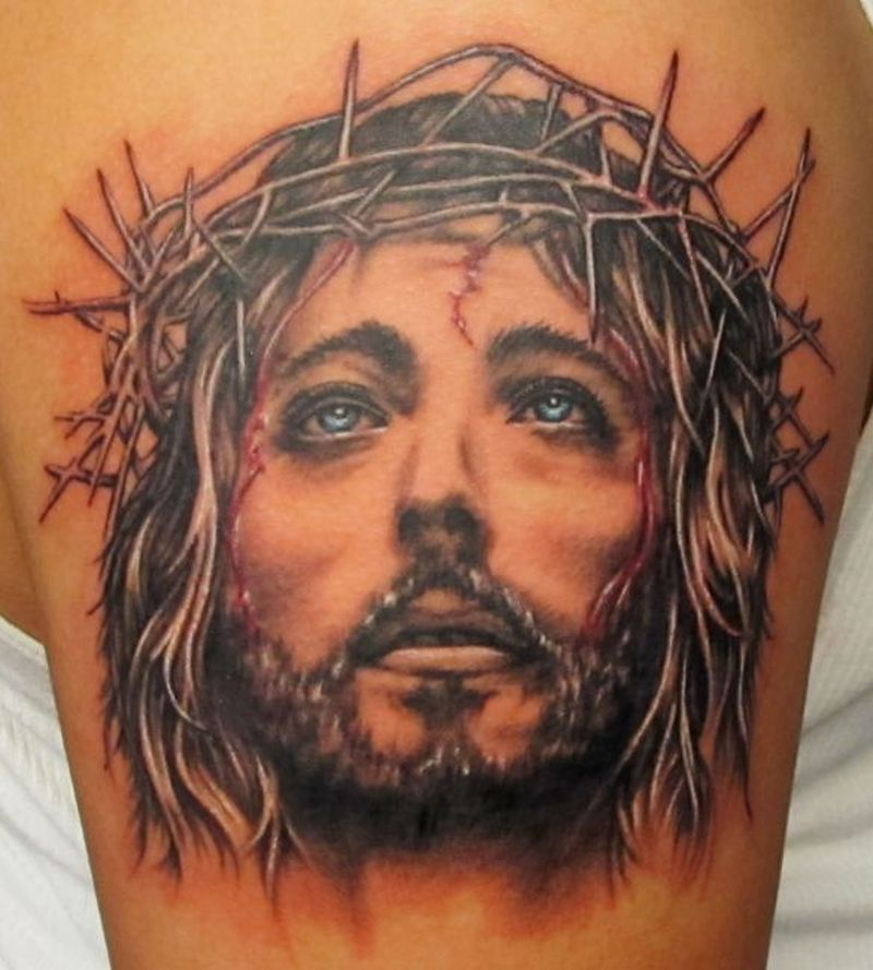 Religious tattoo on shoulder