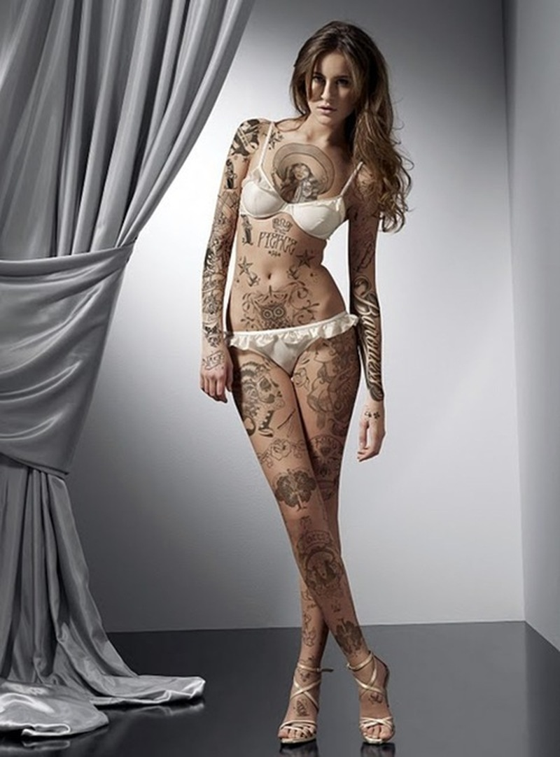 Sexy girl with extreme tattoo design