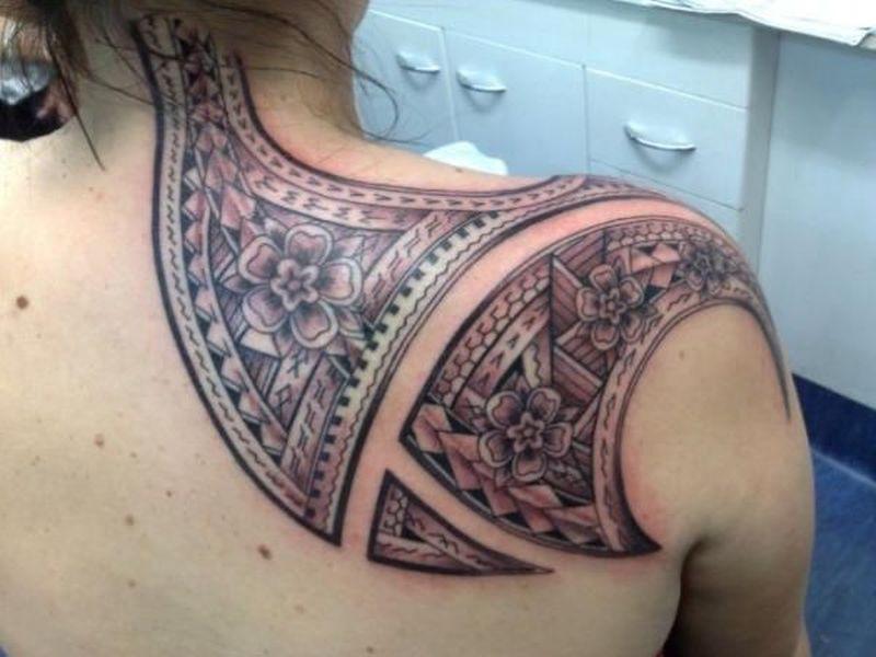 Shoulder blade and back neck tribal tattoo