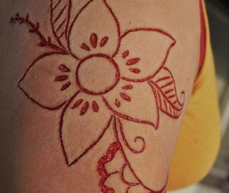 Skin scarification floral pattern on shoulder tattoo