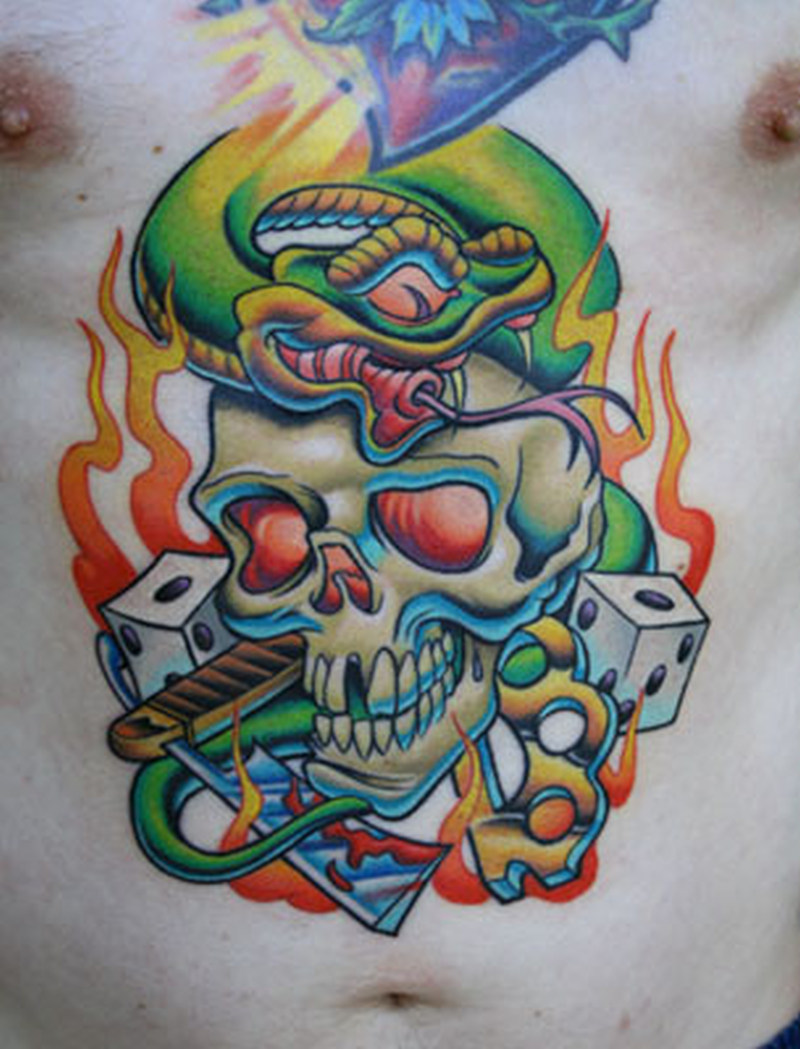 Skull snake dice knuckles tattoo on stomach