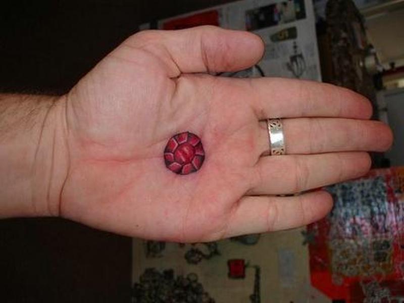 Small geek tattoo on palm