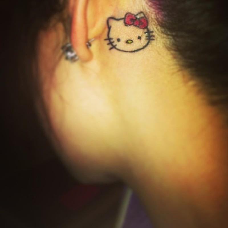 Small hello kitty tattoo below ear