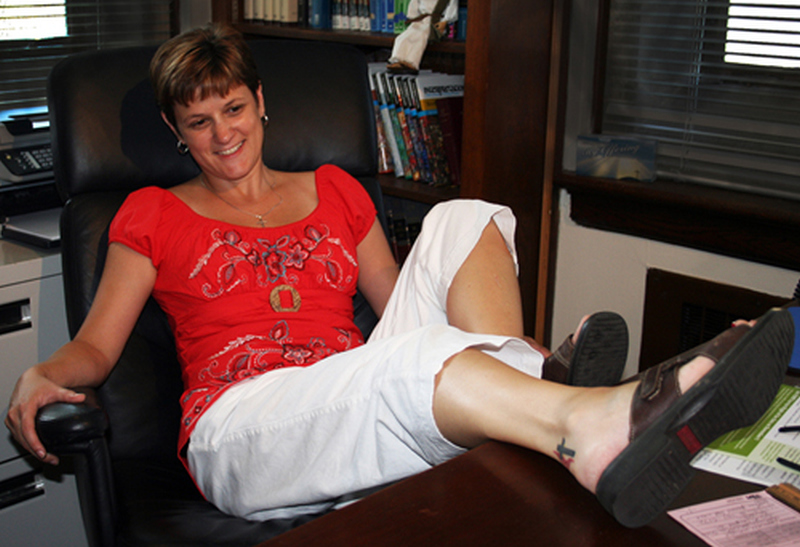 Smiling woman with heel tattoo design