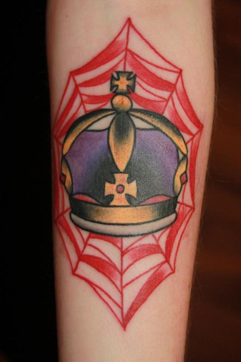 Spider web crown tattoo on skin