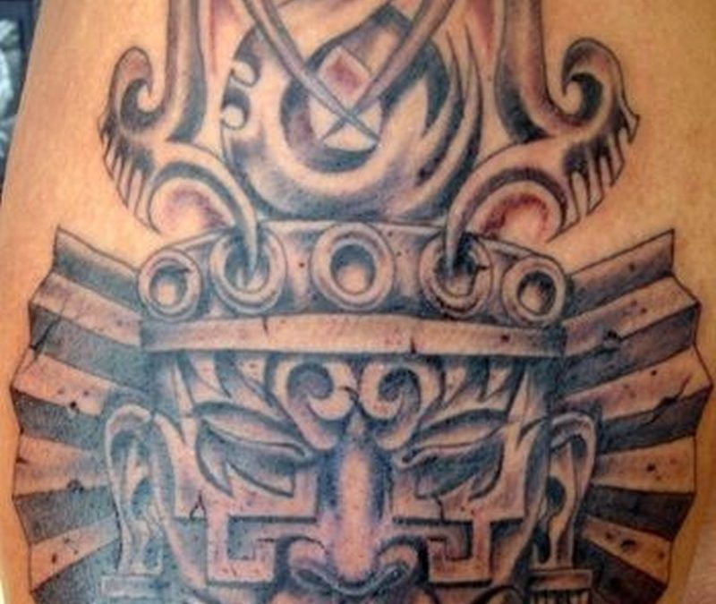 Stone mask of aztec deity tattoo