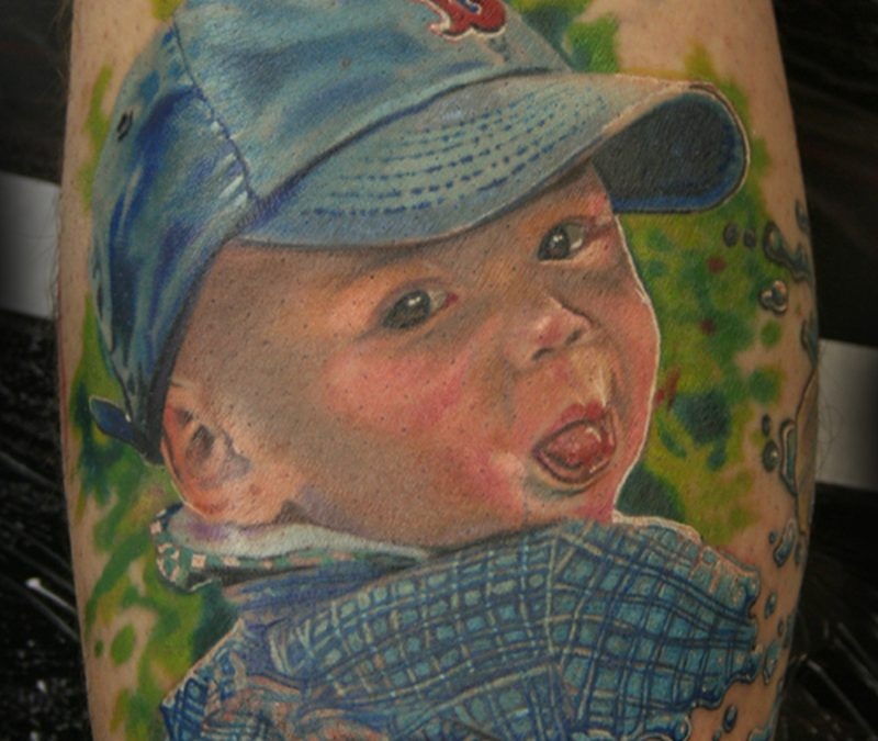 Superb tattoo design of baby boy