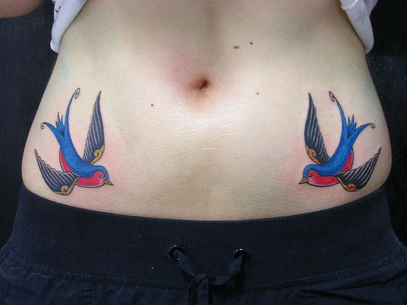 Swallow birds tattoo on lower stomach
