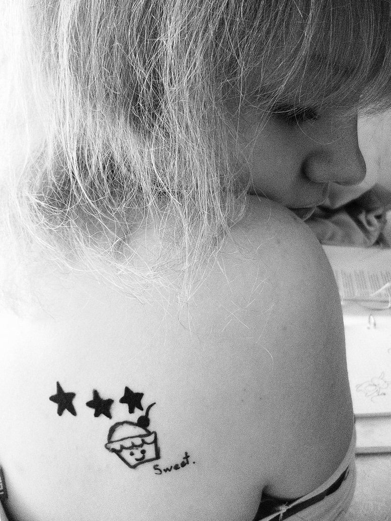Sweet cup cake with stars tattoo design