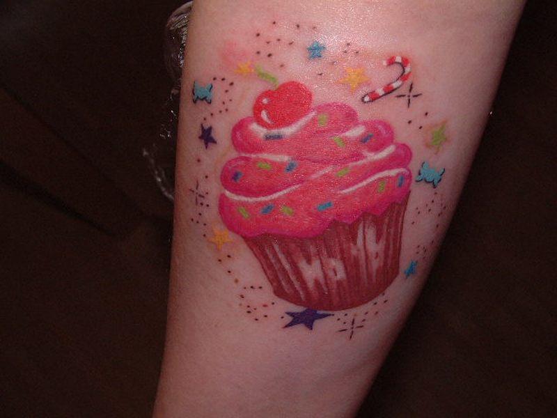 Terrific cup cake tattoo design