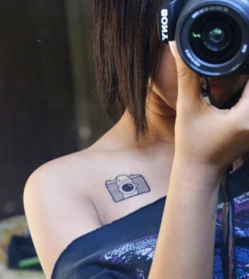 Tiny camera tattoo on collarbone