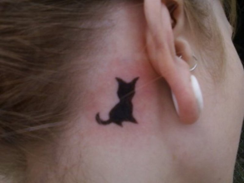 Tiny cat tattoo behind ear 2