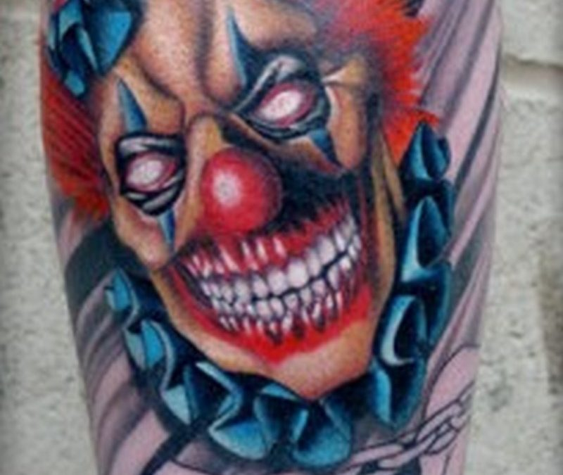 Top arm clown tattoo