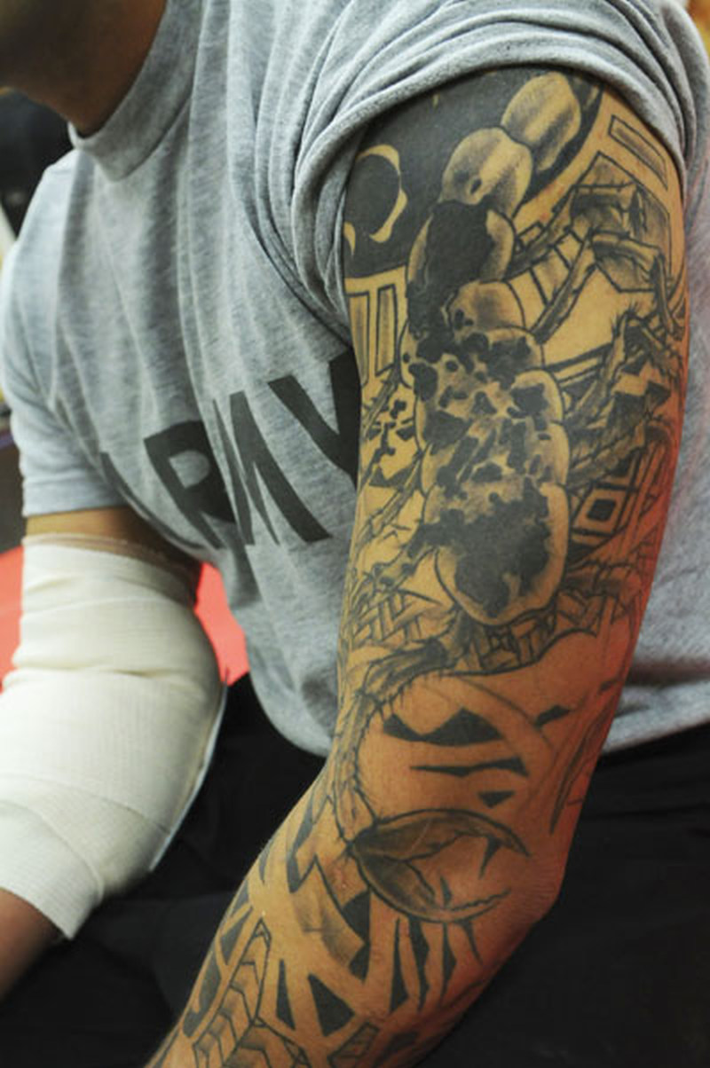 Tremendous full sleeve army tattoo design