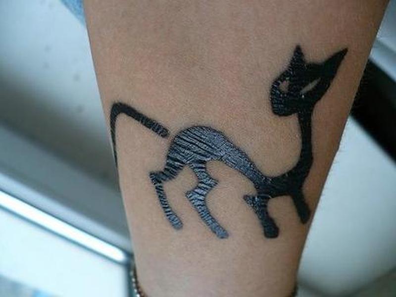Trendy cat tattoo