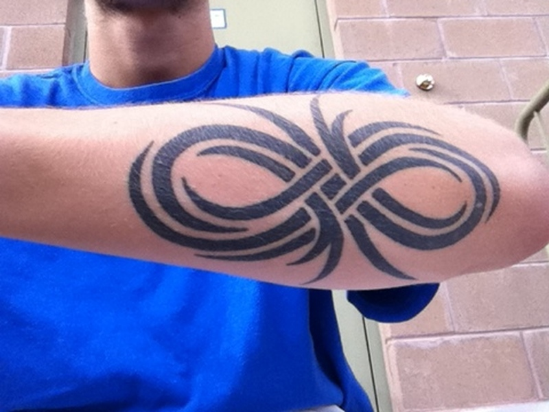 Tribal infinity symbol tattoo for men