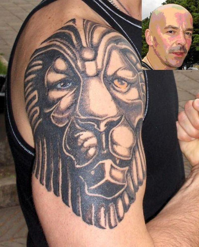 Tribal lion biceps tattoo design