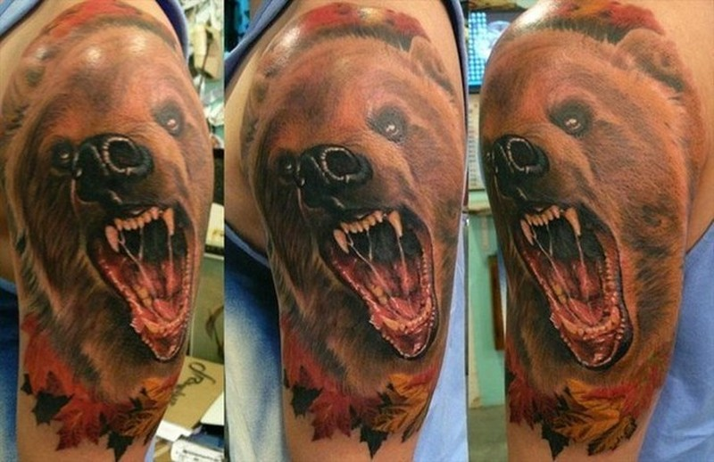 Watercolor head of a bear with open mouth tattoo on shoulder